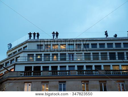 Paris, France - 11 May 2019 People On High Observation Rooftop Of Building Look Down Night. Many Peo