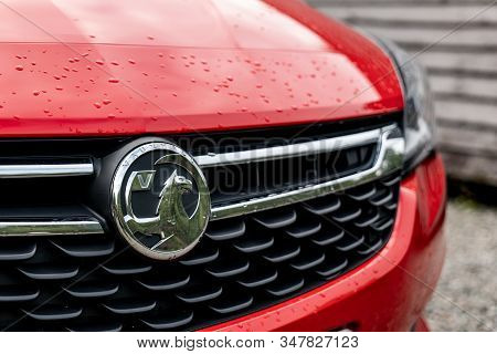 Scotland - August 2, 2019: The Frontal Part Of A Red Vauxhall Astra Hatchback Car With A Grill And B