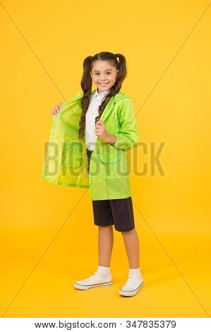 Season Is Changing. Small Girl Raincoat. Active Schoolgirl Waterproof Raincoat. Water Resistant Clot