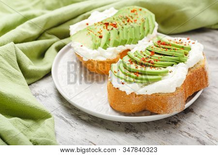 Two Avocado Toasts On Gray Plate, Avocado Sandwich. Fresh Avocado Sliced On Toast Of Wheat Bread, Cr