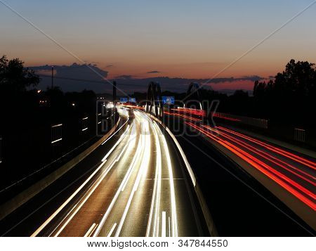 Long Exposure Image Of The German Autobahn A8 Near Augsburg During Sunset
