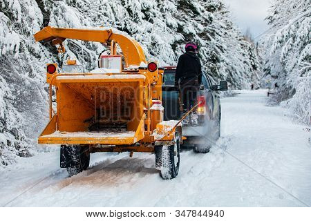 A Wide View Of An Arboriculturist, Tree Surgeon Or Landscape Gardener, Towing A Mobile Wood Chipper