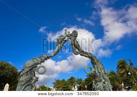 PLAYA DEL CARMEN, QUINTANA ROO, MEXICO - DECEMBER 27, 2016 Portal Maya sculpture in Mayan riviera of Mexico. 16 meters high and 16 ton of weight by Jose Arturo Tavarez Padilla.