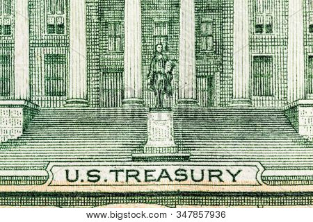 Macro close up photograph of the US Treasury Building on the Ten Dollar Bill.