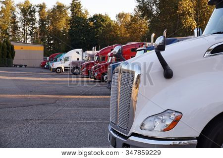 A Row Of Trucks During A Stopover, Travel Breaks. Stop For Trucks.