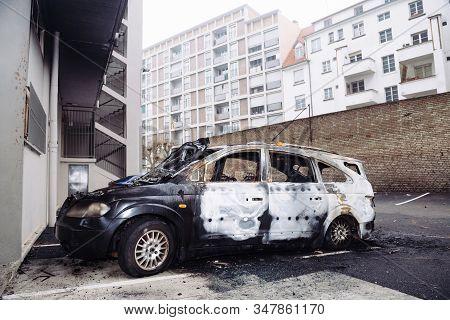 Strasbourg, France - Jan 1, 2020: Empty Street With Burnt Car As Vandals In Strasbourg, France, Mark