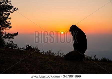 Silhouette Of Christian Man Hand Praying