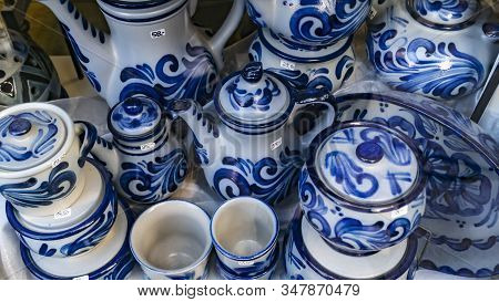 Traditional German Stoneware Painted In Blue Get Offered In A Showroom