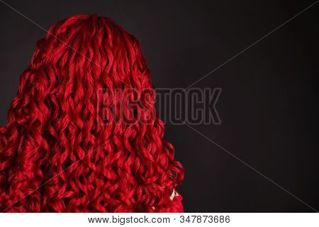 Redhead Girl With Brilliance Long Wavy Hair. Red Wig. Natural Beauty. Young Girl With Kinky Hair. Vo