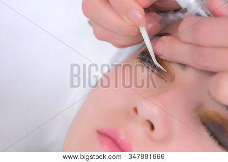 Cosmetologist Bending Lashes With Needle Into Curlers, Lift Eyelashes Laminaton Procedure In Beauty