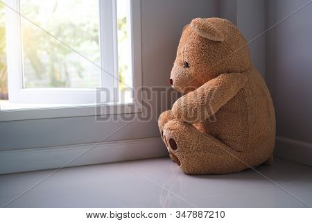 Major Depressive Disorder Mdd Concept. Grief Of Children. Teddy Bear Sitting Looking At The House Wi