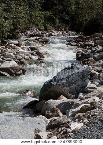 Creek Downstream With Stony Shore