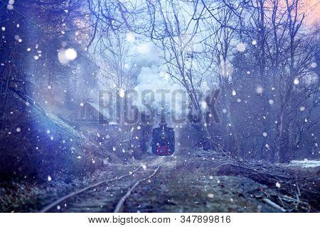 Fairytale photo of Mocanita train in snowfall - the steam train from Maramures, Romania.