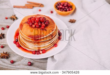 Stack Of American Pancakes With Fresh Cranberry And Jam In White Plate On Wooden Rustic Table. Delic