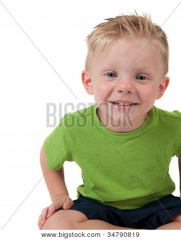 Young Happy Boy Sitting On White