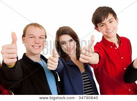 Three Teenagers On A White Background With Thumbs Up
