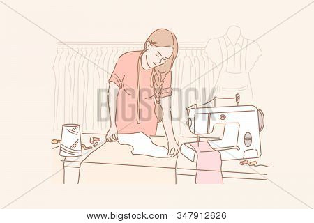 Tailor, Dressmaking, Sewing Concept. Young Woman Is Sewing Clothes In Her Clothing Store. Dressmakin