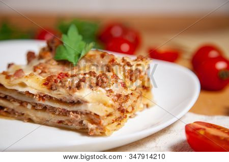 Portion Of Tasty Italian Lasagne Served On White Plate