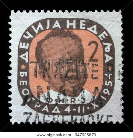 ZAGREB, CROATIA - JUNE 27, 2014: A stamp issued in Yugoslavia shows Head of an infant, Children's Week, circa 1954.