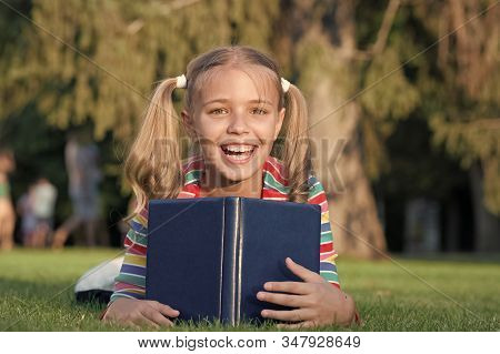 My Education Came From Encyclopedia. Happy Little Girl Read Encyclopedia On Green Grass. Adorable Sm