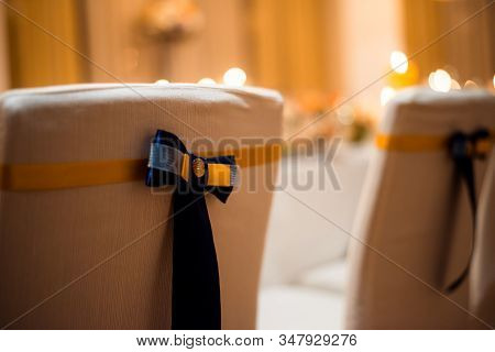 Chairs Are Decorated In The Banquet Room. A Comfortable And Stylish Chair For A Banquet.