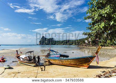 Krabi, Thailand - November 28 2019: Brown Wooden Long Tail Boat On A Beach. Ko Phi Phi Island In Tha