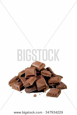 Vertical Image Of Pile Of Chocolate Chunks Isolated On White Background With Copy Space
