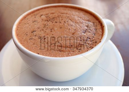 Closeup A Cup Of Mouthwatering Hot Chocolate On Wooden Table