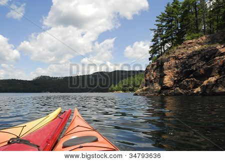 Three Kayaks Point To The Wilderness
