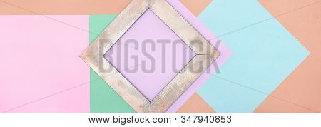 Wide Minimalistic Background With Pastel Colored Paper Blocks And Shabby Chic Wooden Frame. Abstract