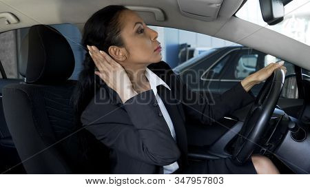 Businesswoman In Car Looking In Rear-view Mirror, Overconfidence, Narcissism