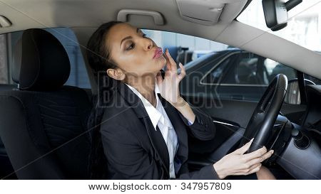 Beautiful Business Female Sitting In Luxury Auto And Looking In Mirror, Glamour