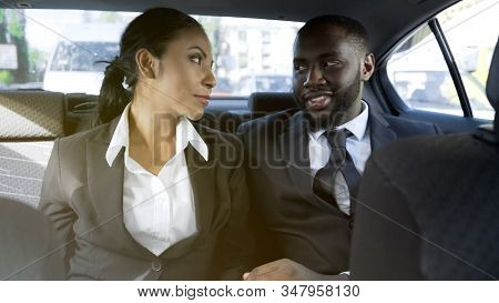 Affectionate Business Woman And Man Flirting In Car, Office Romance, Affair