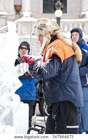 St. Paul, Mn/usa - January 25, 2020: Ice Sculptor At Multi-block Ice Carving Competition Shaping Ice