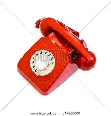 Red telephone handset on white background