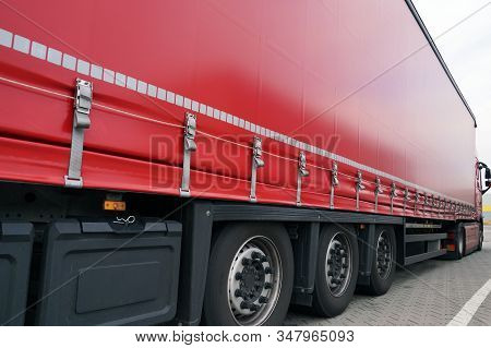 Truck Transport. View Of The Tarpaulin Covering The Semi-trailer Of The Truck.