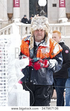St. Paul, Mn/usa - January 25, 2020: Ice Sculptor At Multi-block Ice Carving Competition With Tool I