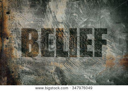 Belief written on steel background