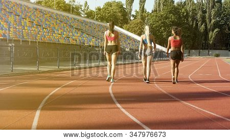 Multi-ethnic Female Students Going To Locker Room After Workout At Stadium
