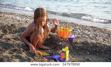 Kid Building Castle On Beach At Sunset, Child Playing Sands, Girl On Seaside, Ocean View