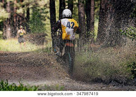 Back Rider Enduro Bike Riding Puddle Of Water And Mud