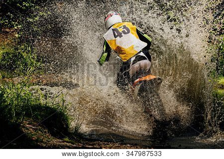Back Rider Enduro Motorcycle Riding Puddle Of Water And Mud, Splashes And Drops