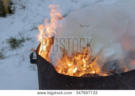Minsk. Belarus, January 29, 2020. Burning Garbage In A Metal Barrel. The Concept Of The Destruction