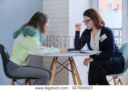 Woman Social Worker Talking To Teenage Girl. Psychological Assistance In Adolescence. Mental Health