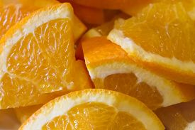 Delicious Succulent Orange Fruit Slices With Healthy Vitamins. Many Orange Pieces With Skin And Pulp