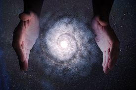 Creationism Concept. Hands Of God Are Creating Galaxy In Universe.
