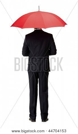 Back view of man in suit with opened red umbrella, isolated on white