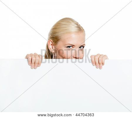 Girl looks out of the huge sheet of paper - copyspace for the text, isolated on white