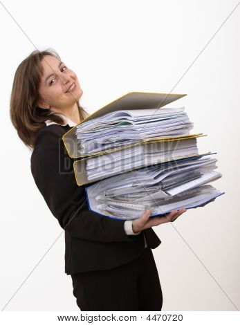 Smiling Business Woman Wearing Heavy Files