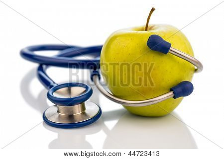 an apple and a stethoscope with a doctor. representative photo of healthy and vitamin-rich diet.